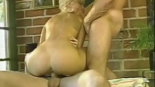 Slender blonde gets her holes filled with two cocks