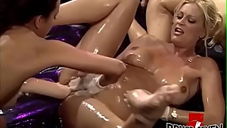 Lubed up lesbians fingering and ass fucking in hardcore orgy