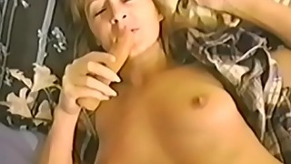 Lusty bimbo masturbates before taking it up her hairy hole