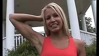 Melissy flexing her biceps