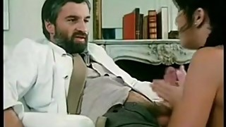 Bearded doctor being sucked by nurse