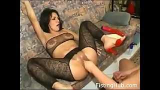 Slut gets extreme fisting, deepthroats dildo, legs spread, she LOVES it!