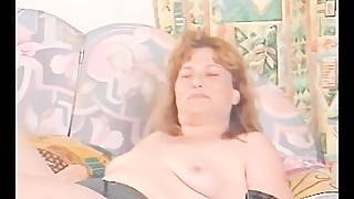 MILF with natural tits shows her pussy