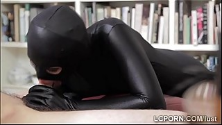 Fetish beauty with perfect body wears a tight latex suit to give a blowjob