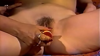 Vintage lesbians play with a long double ended dildo
