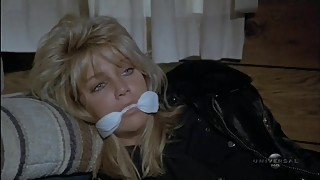 Heather Locklear is a tied up policewoman